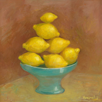 Seven lemons in a blue vase